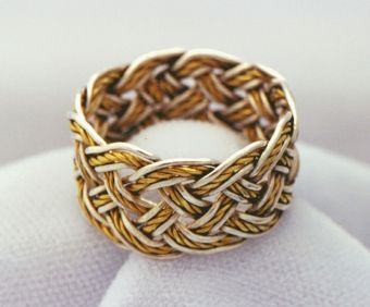 Pure silver and gold five-lead by eleven-bight ring.