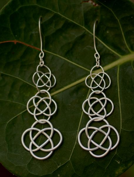 Silver graduated knotted chain mail earrings.