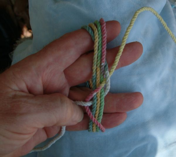 Tying a seven-lead twelve-bight knot in hand.
